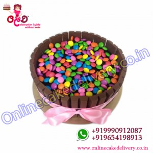 Send Half Kg KitKat Gems  Cake to India